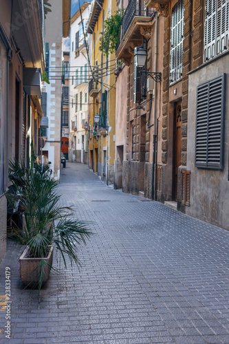 one of the many narrow streets of the old town in Palma de Mallorca