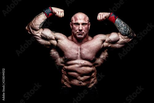 Muscular Man on Black Background - 238344312