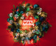 "top view of christmas wreath decorated with toys and lights on red background with ""happy holiday"" lettering"