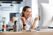 Leinwanddruck Bild - Happy young businesswoman sitting at her workplace