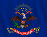 North Dakota US state flag with waving effect, official proportion.