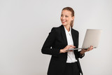 Happy young business woman wearing suit isolated
