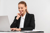 Pretty young business woman wearing suit isolated - 238354703