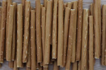 Salty stick crackers on wooden desk