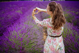 woman in lavender field showing heart shaped hands