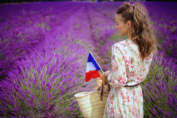 woman at lavender field with straw bag and French flag