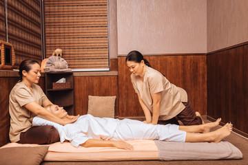 Beautiful young woman visiting Thai massage salon © Viacheslav Iakobchuk