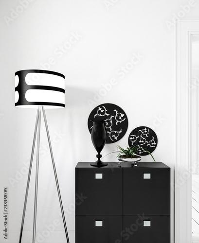 Fototapeta Schwarze Kommode Vor Weisser Wand Mit Stehlampe Und Deko
