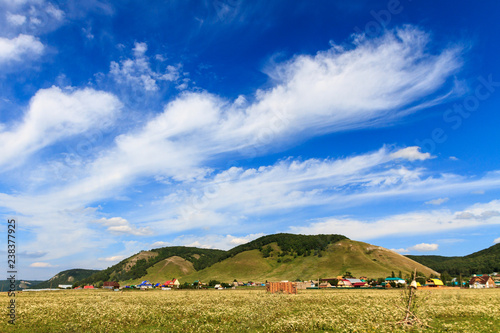 landscape, view of the village, mountains, blue sky with clouds in summer sunny day - 238377925