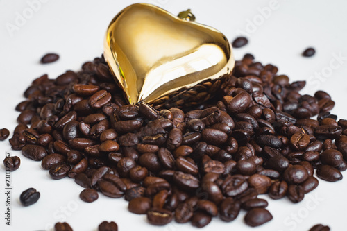heart shaped decoration on coffee beans