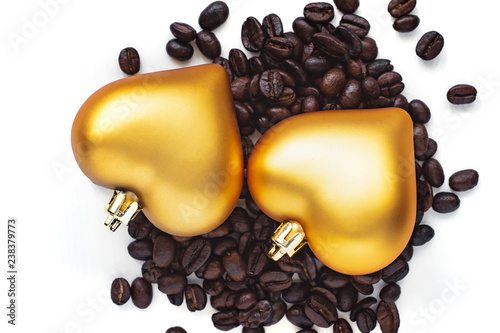 pair of heart shaped decoration on coffee beans