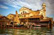 Quadro Boatyard in Venice with church
