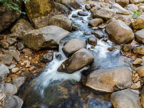 water flowing over rocks - 238387540