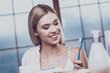 Optimistic woman looking at the toothbrush