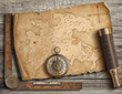 Old medieval island map with compass and spyglass. Adventure and travel concept. 3d illustration.