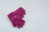 pink gloves on snow background - 238427513