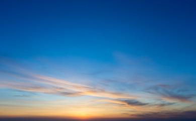 Colorful sunset sky over tranquil sea surface © Pakhnyushchyy