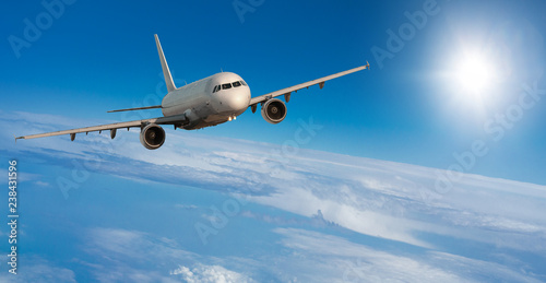 Passenger airplane flying at flight level high in the sky
