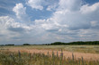 Cloudy sky over the meadow in the summer