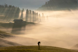 Man in the fog, Alpe di Siusi, Dolomites, Italy