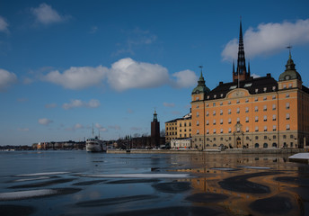 Winter view of Stockholm a frozen lake Mälaren and snow over the Town City Hall and the island Riddarholmen  © Hans Baath