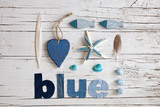 flat lay coastal beach blue denim still life with word blue cut out denim letters and copy space