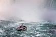 Niagara Falls in Canada. A boat with tourists approaching the Horseshoe Falls.