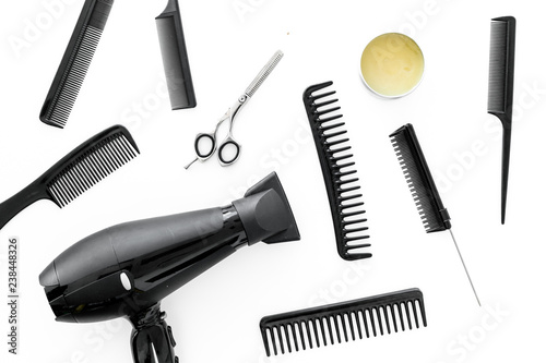 Set of professional hairdresser tools with combs white background top view - 238448326