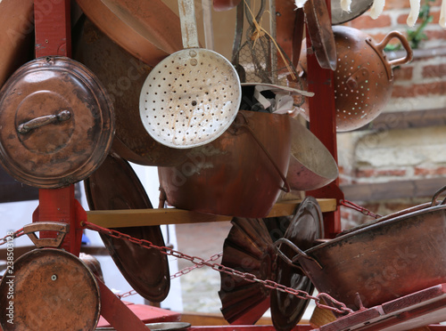 stand of copper objects with pots and kitchen tools