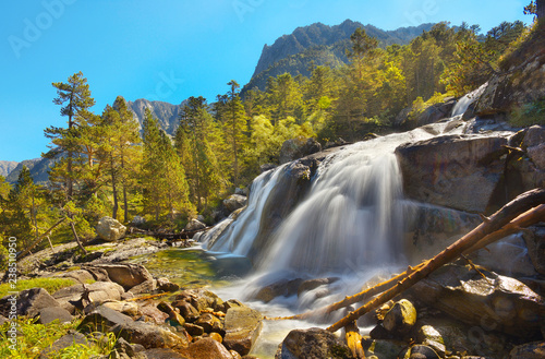 Mountain river with nice waterfall, valley of Gavarnie, Pyrenees Occidentales, France