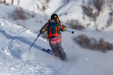 Man skiing in the snow in winter