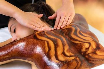 Top view of woman having hot chocolate back massage . © karelnoppe
