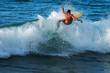 Experienced surfer rides ocean wave on Oahu's North Shore, Hawaii