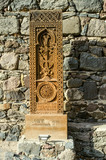 Khachkar from Jugha,carved in the 16th century and its copy,is installed along the road leading to the monastery of Gegard