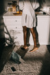 cropped view of legs of african american woman in white kitchen