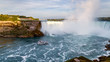 Niagara Falls in Canada. A cruise boat with tourists approaching the Horseshoe Falls.