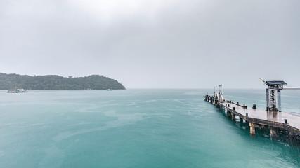 ferry harbor to island in raining day