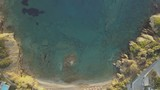 Aerial drone footage of small bay with sandy beach and beautiful turquoise and crystal clear sea - 238592173