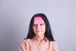 girl forehead glued paper