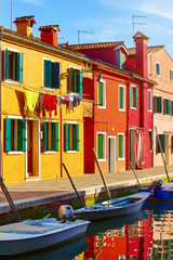 Burano island in Venice Italy picturesque over canal with boats