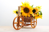 Rattan bicycle with a basket in which there are flowers of sunflowers. Support for flowers. Element of home and garden decor. White background, isolated object - 238612963