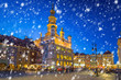 Leinwanddruck Bild - Old town of Poznan on a cold winter night with falling snow, Poland