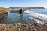 Stone in water on Kirkjufjara beach, Iceland