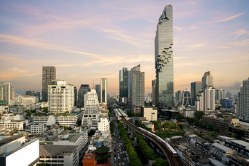 Bangkok Transportation before sunset with Modern Business Building from top view in Bangkok, Thailand. © ake1150
