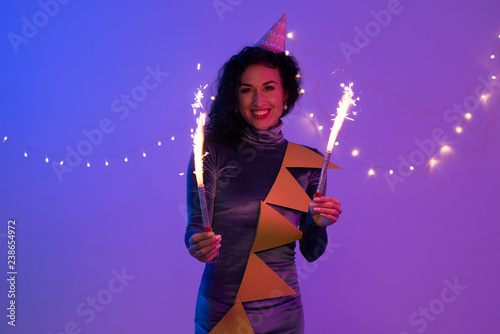 Young woman holding fireworks. Holiday, Event, celebration