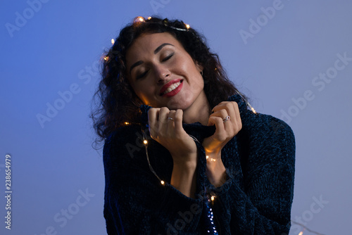 Young woman with xmas glowing lights Celebration, Christmas, New Year, Birthday