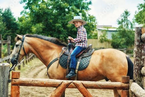 boy riding a horse . children's ranch holidays