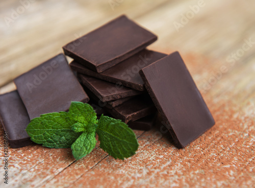 Chocolate and cocoa powder  on a old wooden table - 238676551