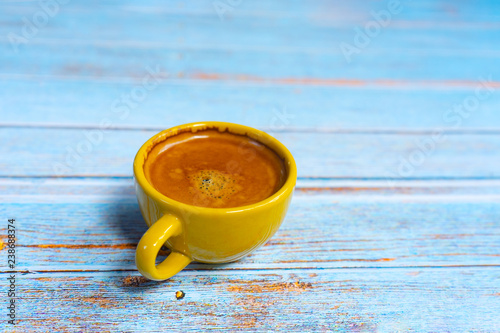 Yellow cup of hot coffee. - 238688374