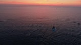 Aerial view. Red sea during sunset. Boat and wakesurfer - 238688939